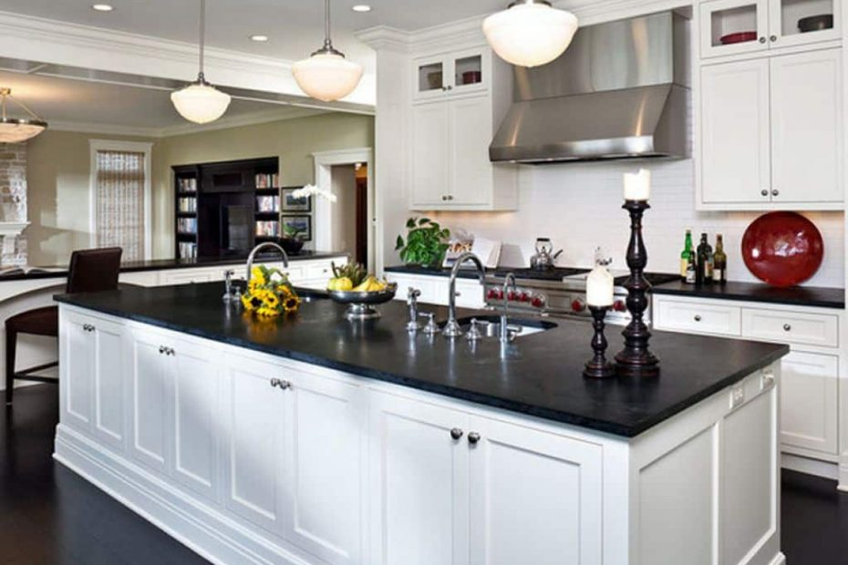 Nice Kitchen With White Cabinets And Black Slate Countertops