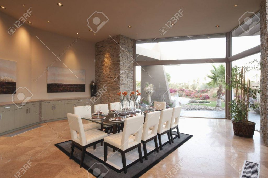 Spacious Dining Room And Kitchen With Floor To Ceiling Windows Stock