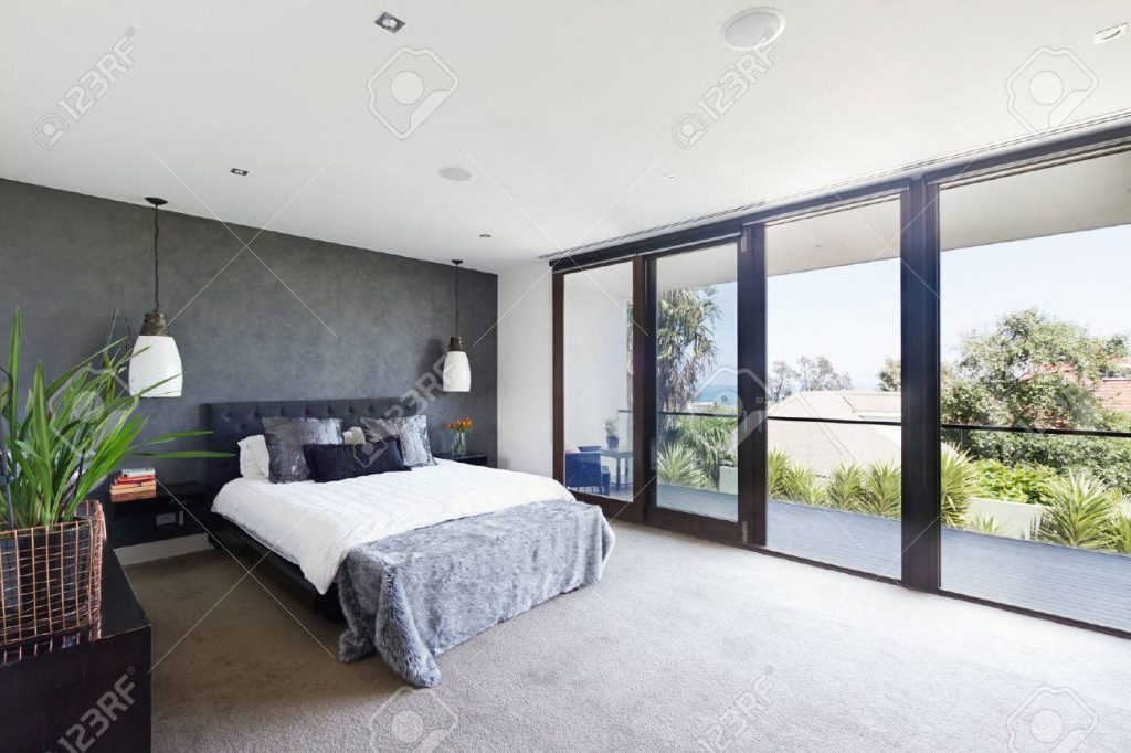 Spacious Interior Of Designer Master Bedroom In Luxury Contemporary
