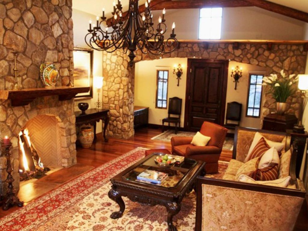 Stone Walls And Traditional Furniture Create A Rustic Living Room