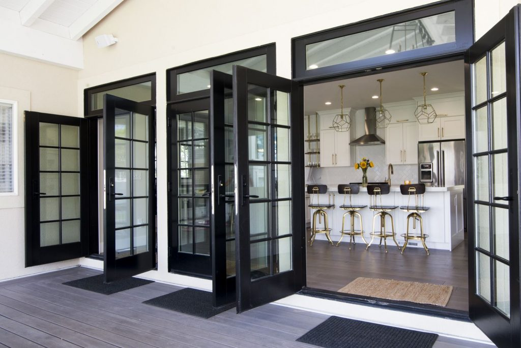 Triple French Doors Off The Kitchen Open Up To Let The Outdoors In