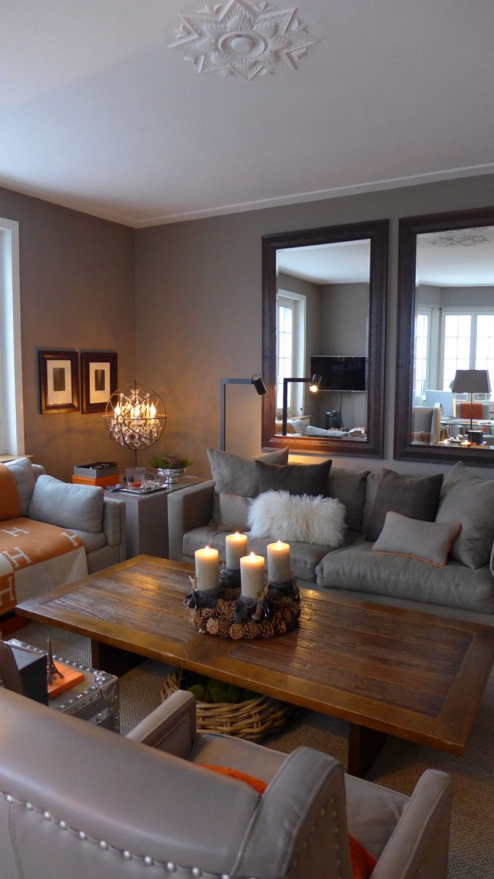 Warm And Cozy Living Room In Taupe With A Touch Of Orange For The