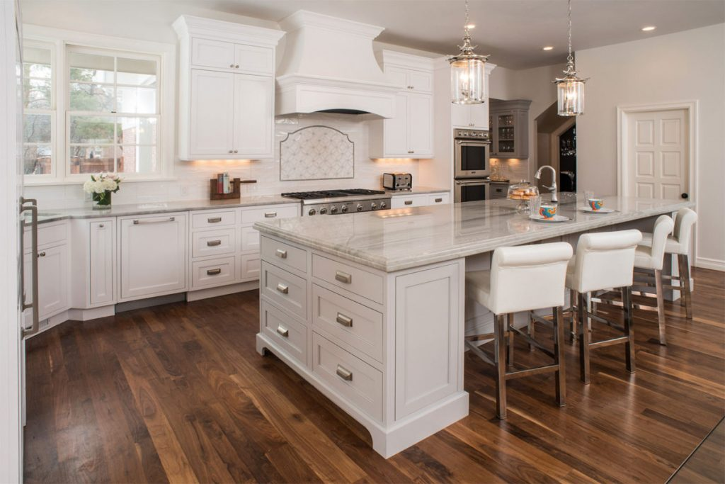 White Kitchen With Light Grey Island Crystal Cabinets