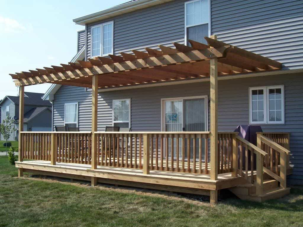 Wooden Backyard Deck With Pergola Adding A Backyard Deck To Your