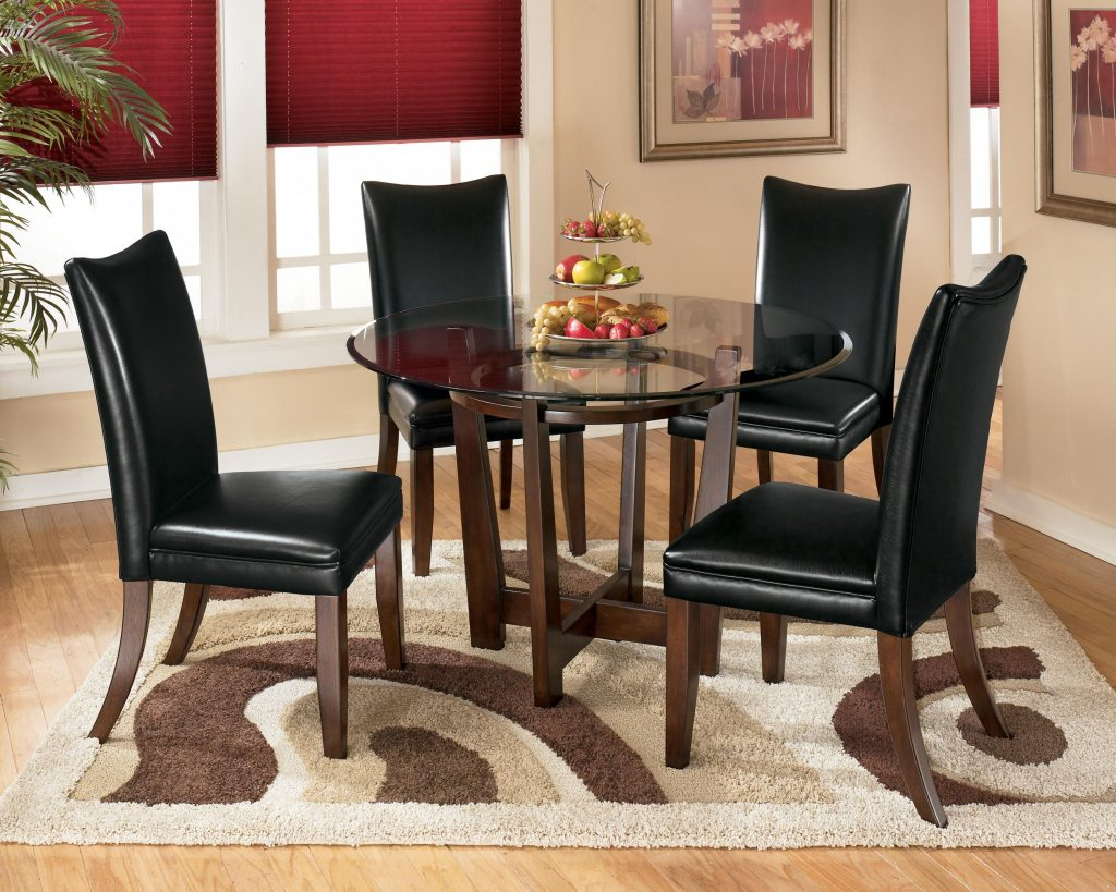 Ashley Signature Design Charrell 5 Piece Round Dining Table Set With
