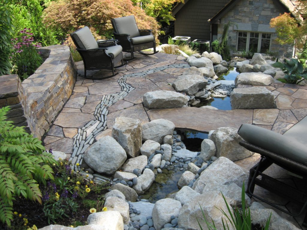 Before And After Patio With Stone River And Curved Stone Wall