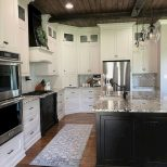 Black And White Luxury Kitchen Cabinets With Dark Wood Ceiling