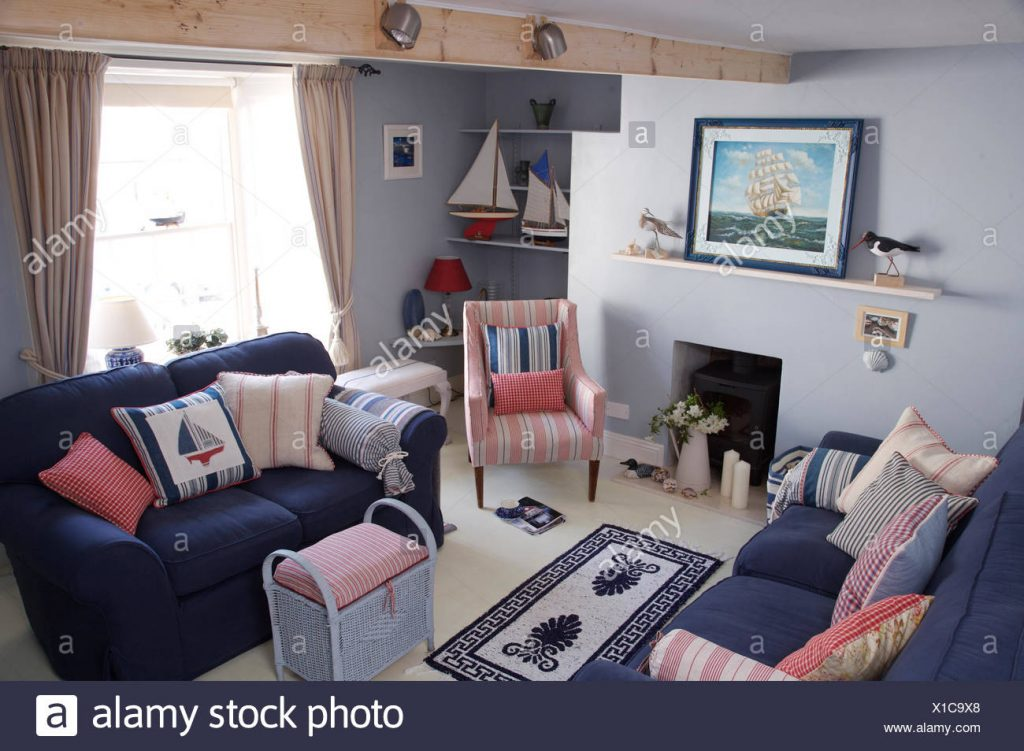 Blue Sofas With Striped Cushions In Coastal Cottage Sitting Room