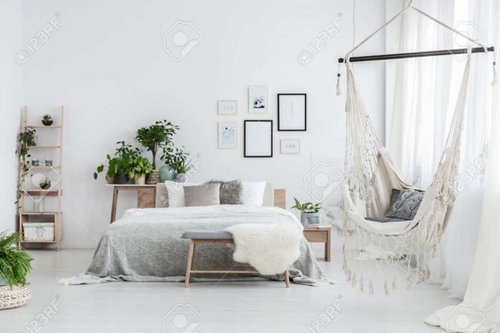 Brazilian Chair With Decorative Cushion Hanging In White Bedroom
