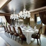 Contemporary Glamour Large Dining Room With Wall Sconces And Double