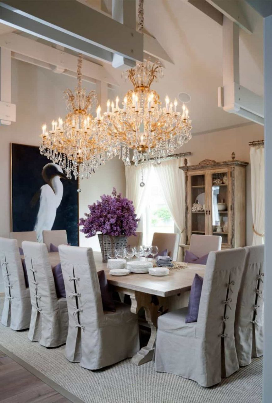 Cottage Style Dining Room Illuminated With Double Grand Crystal