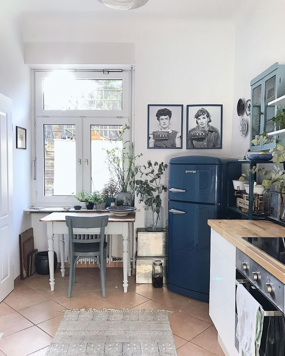 Cute Vintage Inspired Kitchen With A Desk That Does Double Duty As