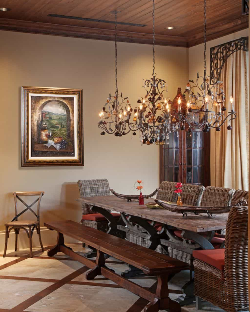 Dining Room Using Three Hanging Wrought Iron Chandeliers Over Wooden