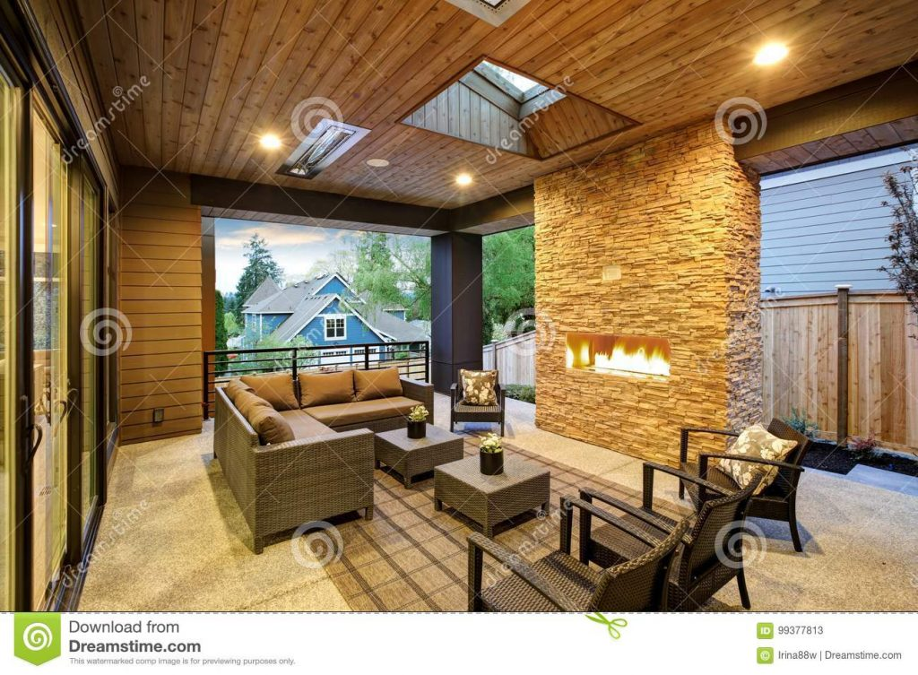 Dreamy Outdoor Covered Patio With Stone Fireplace Stock Image