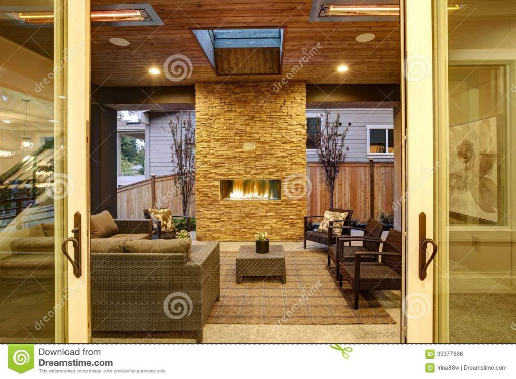 Dreamy Outdoor Covered Patio With Stone Fireplace Stock Photo