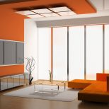 Eye Catching Living Room Paint Color Idea With Stunning Orange Wall