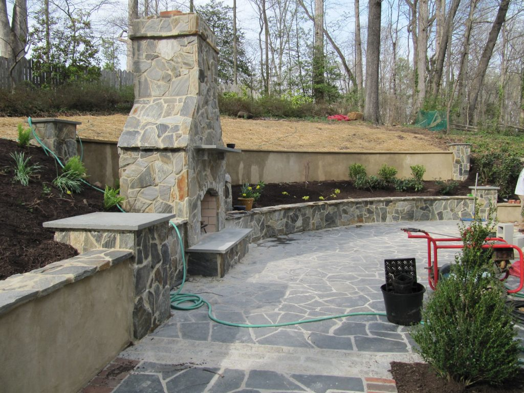Flagstone Patio With Walls With Caps Pillars And A Fireplace Too