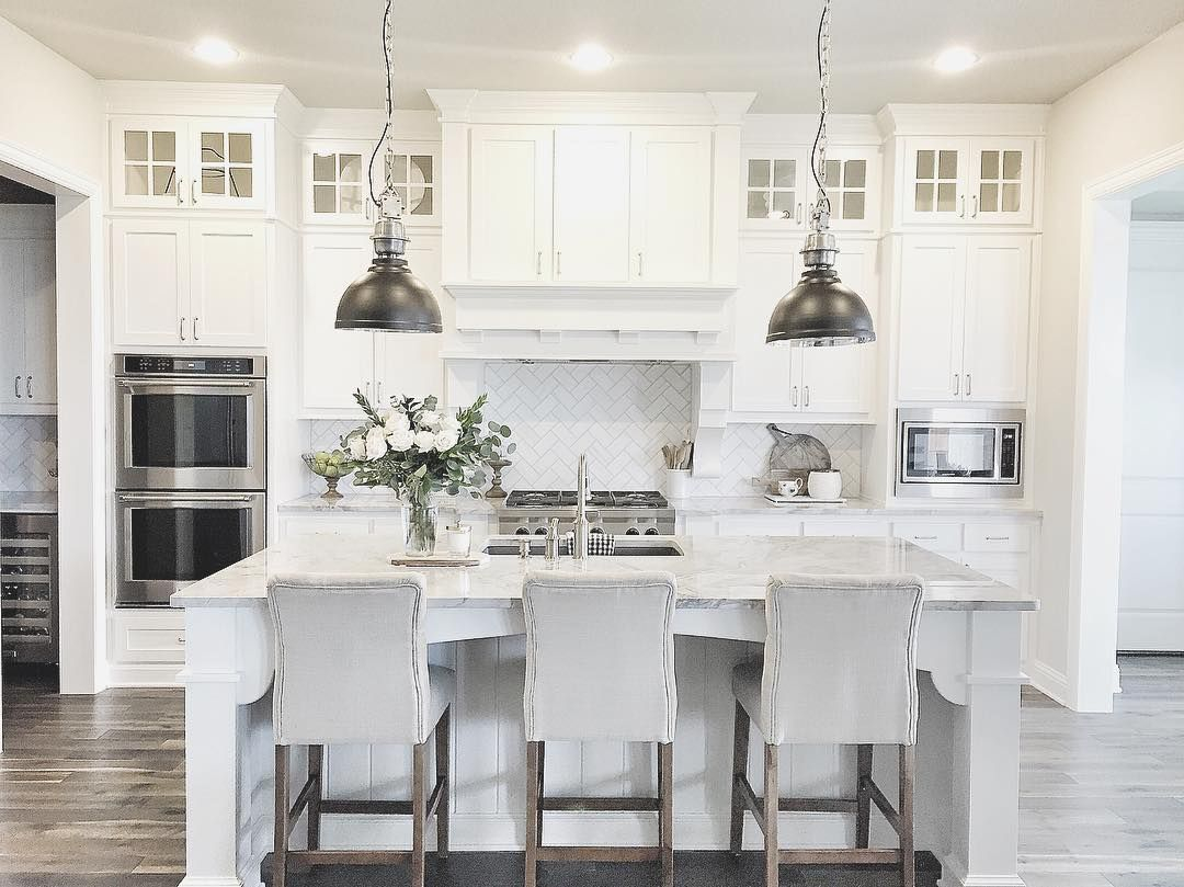 Gray And White Kitchen With Metal Pendant Lamps Over Large Marble Layjao