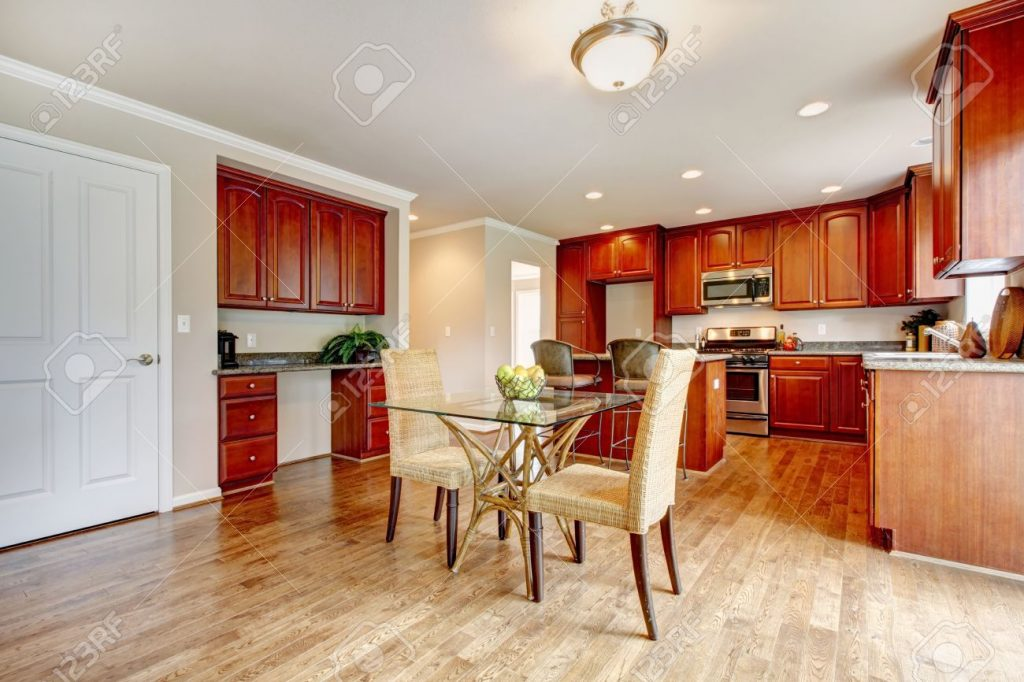 Hardwood Floor Big Kitchen Room With Cherry Wood Cabinets And