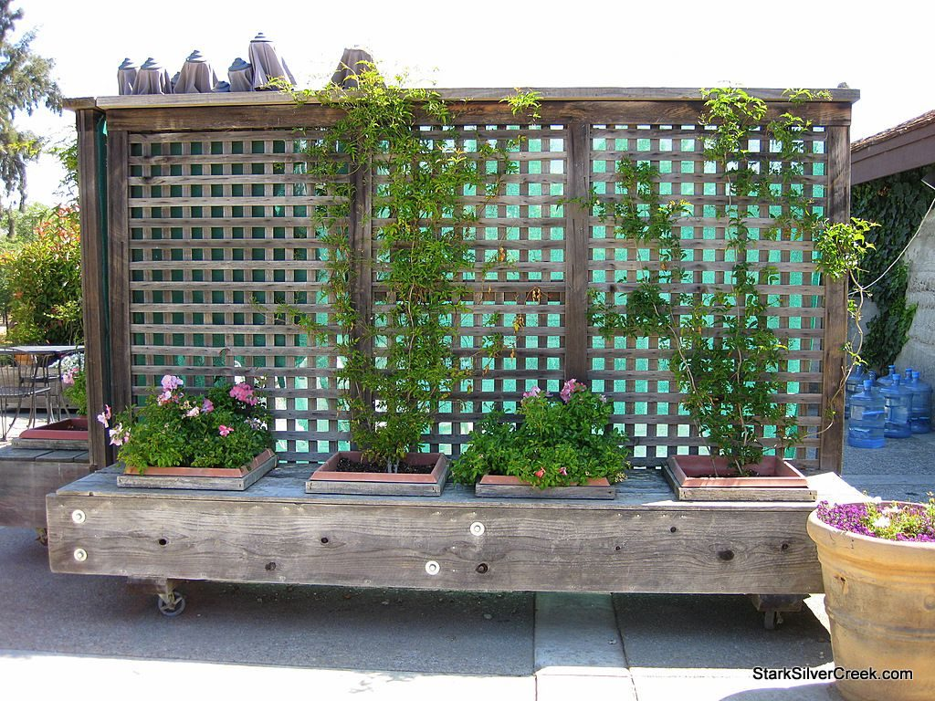 Movable Privacy Fence On Casters With Built In Planters Could Also