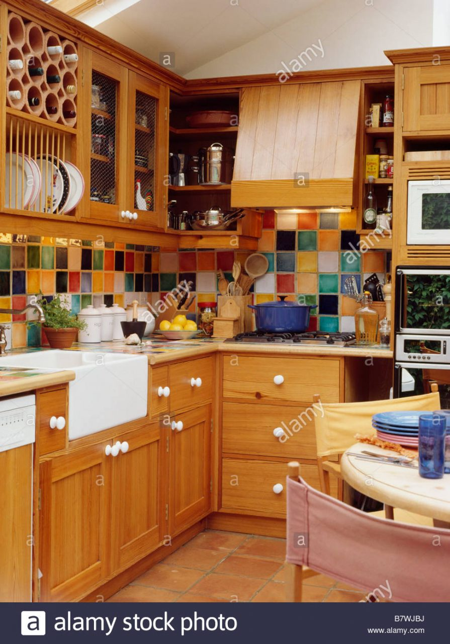 Multi Coloured Wall Tiles In Kitchen Dining Room With Fitted Pine