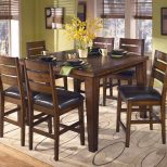 Signature Design Ashley Larchmont Butterfly Leaf Pub Table And 6