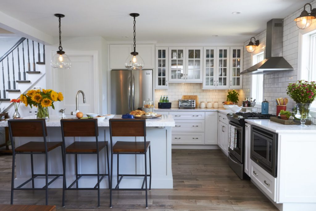 Simply White Kitchen With Light Grey Island Crystal Cabinets