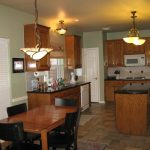 Sage Green Kitchen with Oak Cabinets