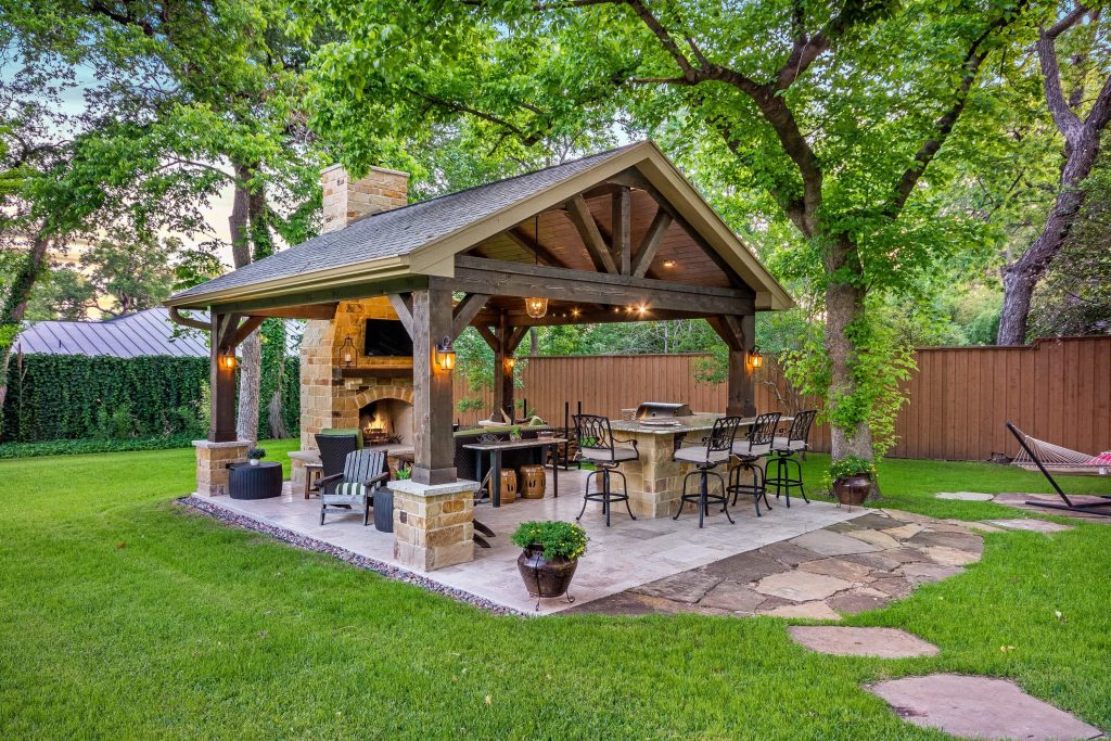 This Freestanding Covered Patio With An Outdoor Kitchen And