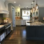 White Cabinets Granite Island Dark Wood Floor Gray Glazed Island