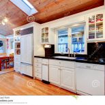 White Kitchen Cabinets With Black Counter Tops In Luxury House