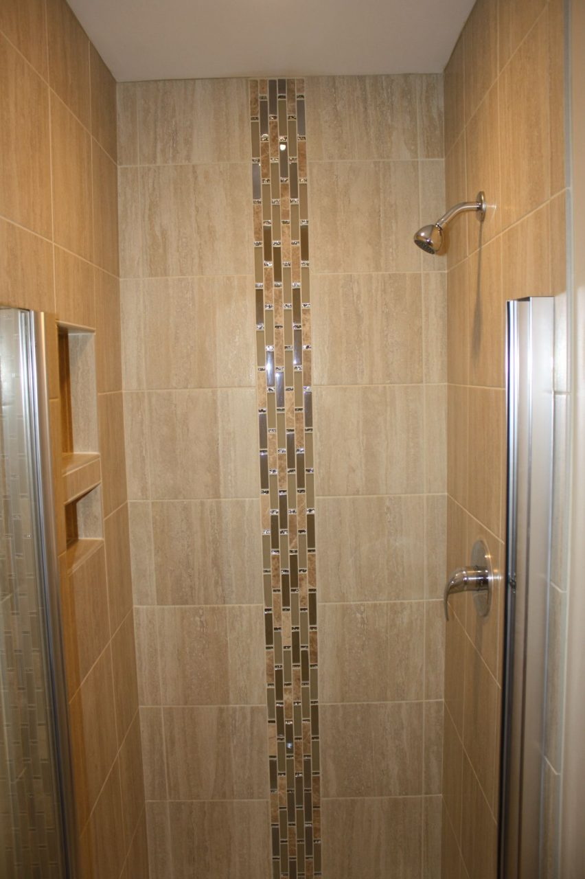 3x3 Shower Area Using 12x12 Porcelain Tiles With A Linear Glass