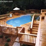 A Hillside Back Yard Including A Swimming Pool Multilevel Decks And