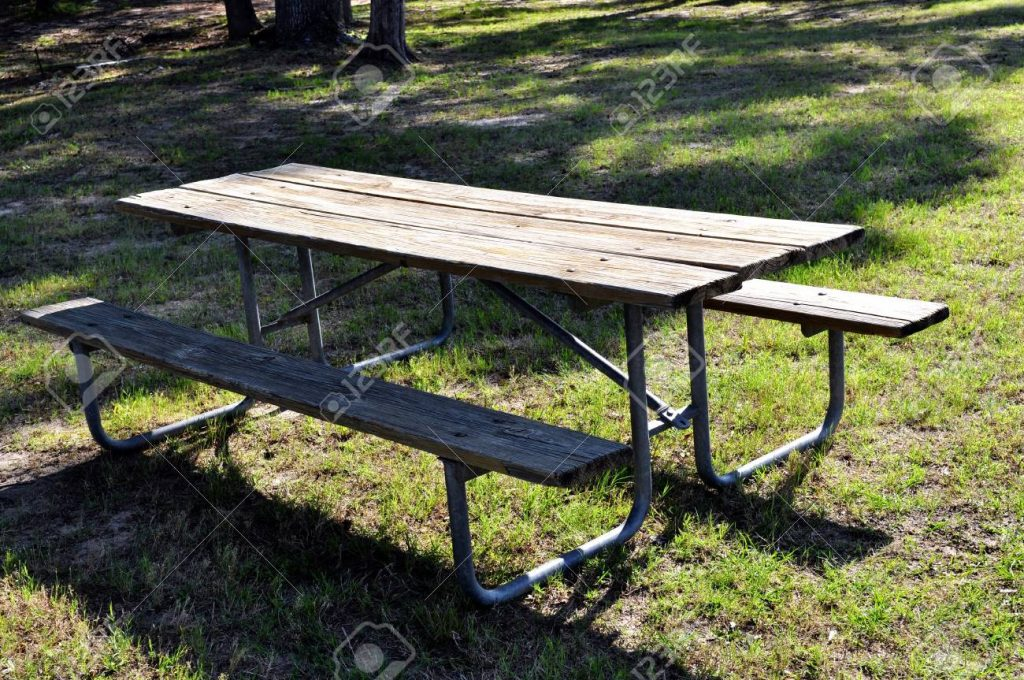 A Old Picnic Table Setting Unused In The Outdoors Stock Photo