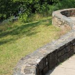 A Serpentine Stone Wall Borders A Terrace At Lake Mcdonald In