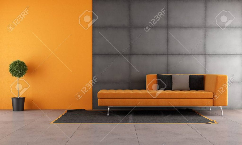 Black And Orange Living Room With Contemporary Sofa Stock Photo