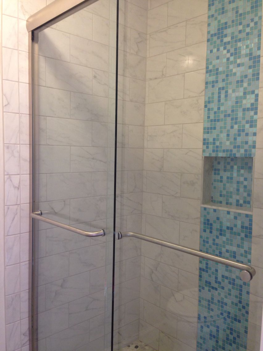 Blue Glass Mosaic Tiles Create A Visual Waterfall In This Newly