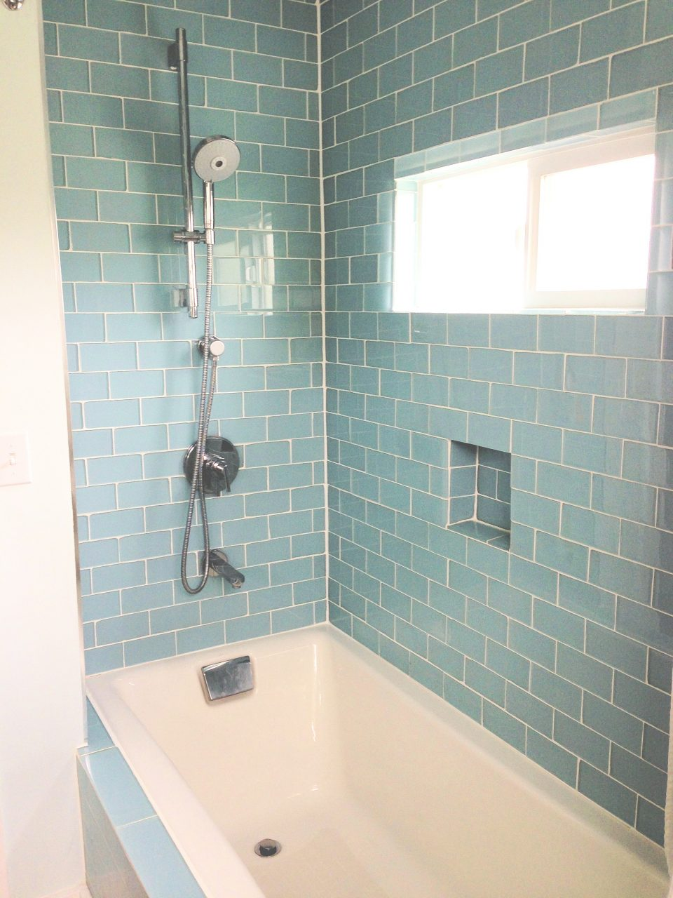 Blue Wall Tile Connected White Bathtub And Stainless Steel Shower