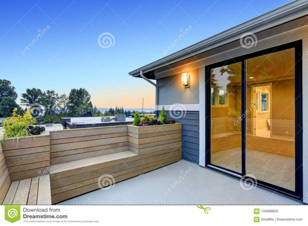 Contemporary Deck With Wood Bench And Planter Boxes Stock Image