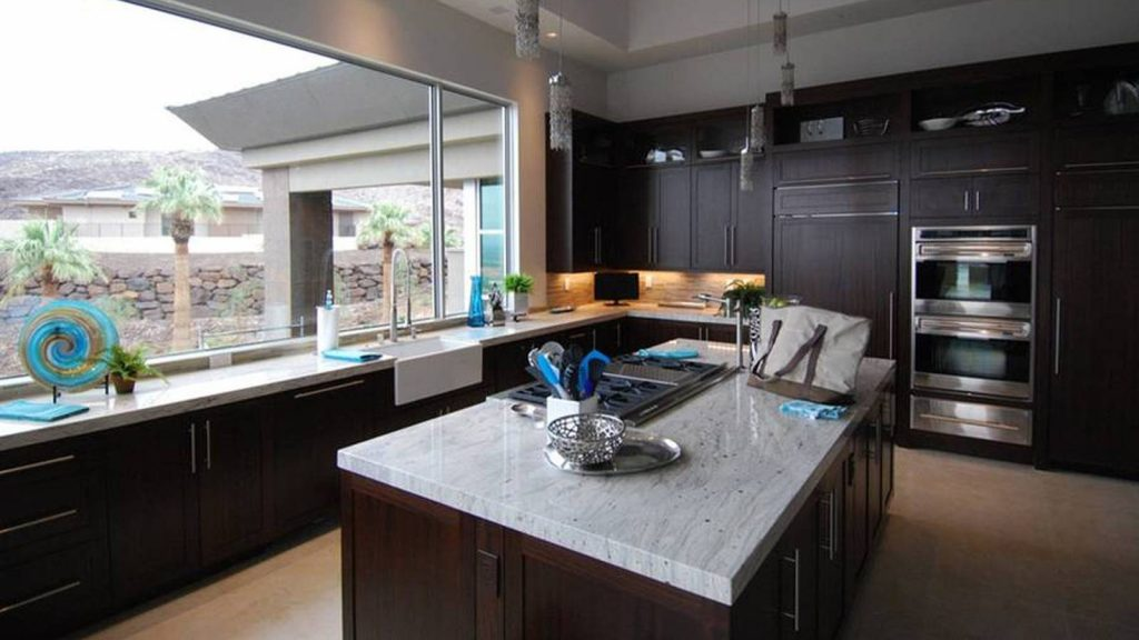 Contemporary Kitchen With Dark Wood Cabis And White Marble Mahogany