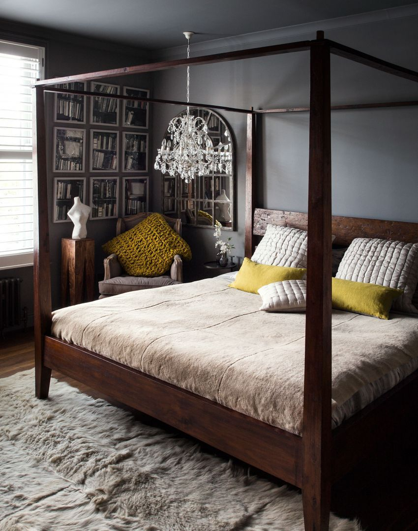 Dark Atmospheric Bedroom With Four Poster Bed And Low Chandelier