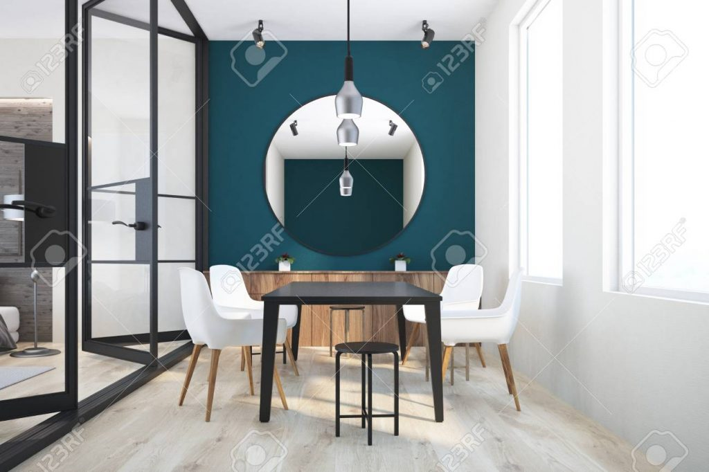 Dark Green And White Wall Dining Room Interior With A Black Table