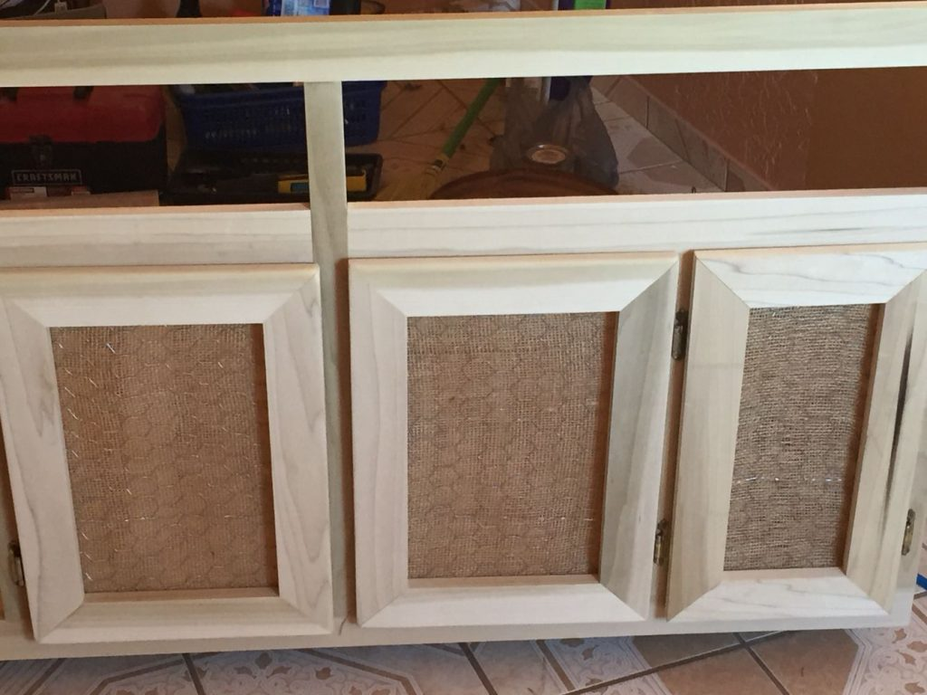 Diy Cabinet Door Used Burlap And Chicken Wire For A More Rustic Look