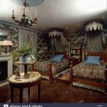 Exotic Style Bedroom With Animal Print Covers On Coronet Topped Beds
