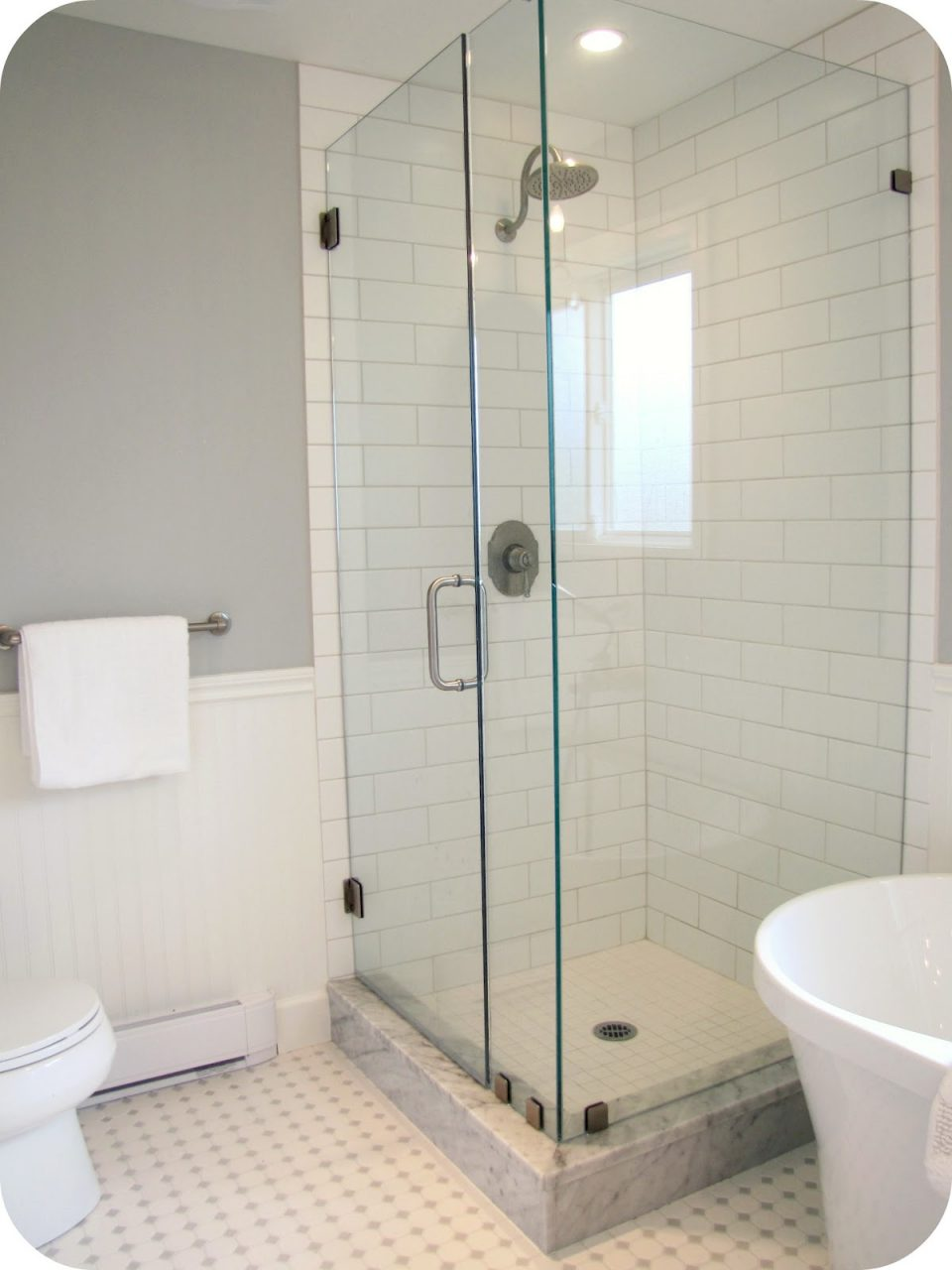 Glass Shower Room With White Wall Tile And Stainless Steel Shower On