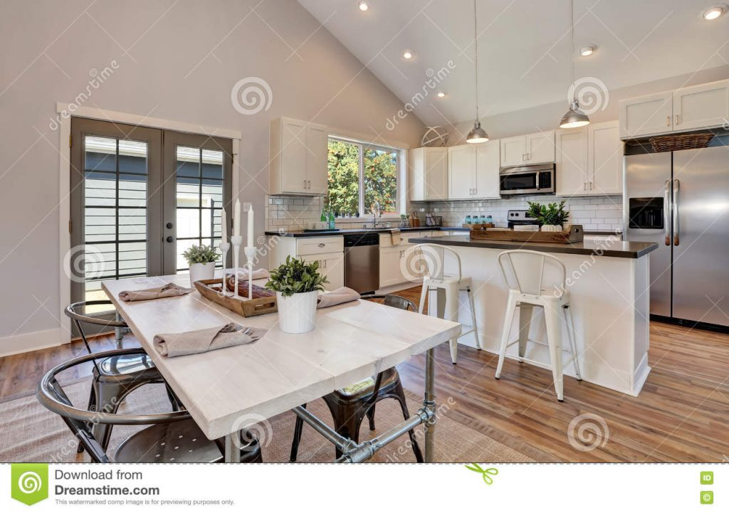 Interior Of Kitchen And Dining Room With High Vaulted Ceiling Stock