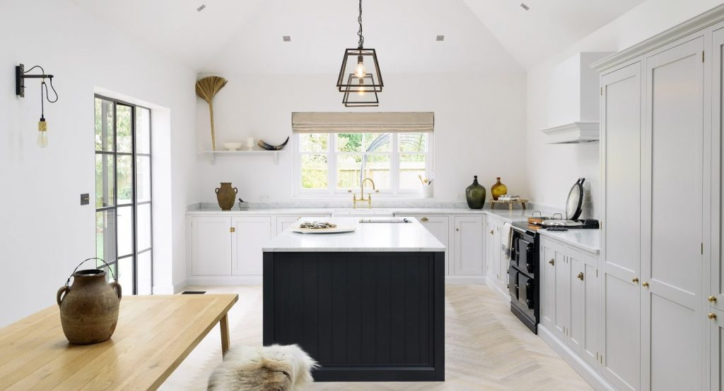 Lofty Modern Farmhouse Kitchen With Shaker Cabinets Skylights