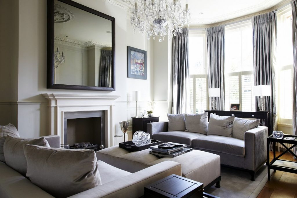 Modern Victorian Living Room With Delightful Grey Sofa And Crystal