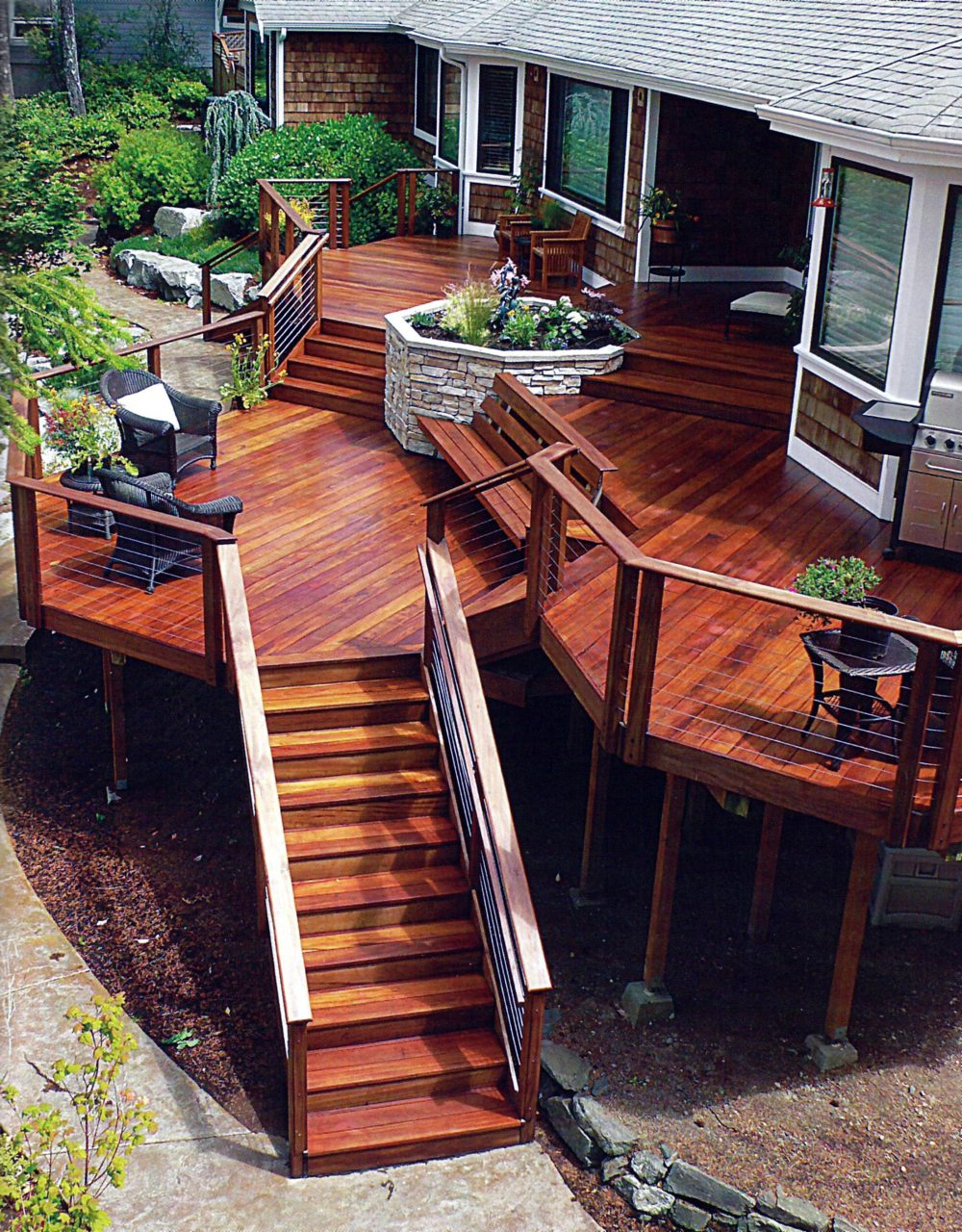Multi Level Deck With A Stone Planter As The Focal Point Decks