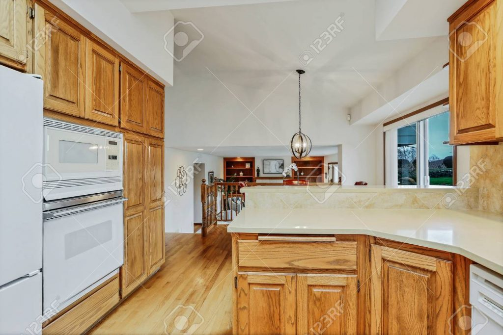 Open Large Kitchen Interior With Vaulted Ceiling And White